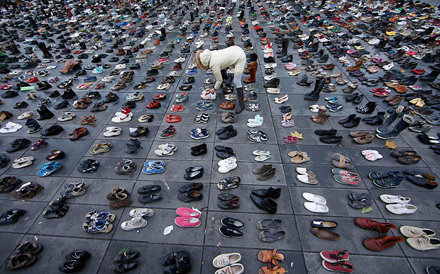 The authorities in Paris have banned any protest marches due to security concerns following the terrorist attacks, so campaigners have left their shoes out instead Photo: REUTERS/Eric Gaillard