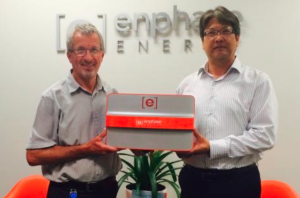 Billy McIndoe and Manuel Shimasaki from Enphase Energy's Christchurch Engineering Office hold the Enphase Storage Solution, a modular 1.2kWh AC Battery with built-in bi-directional microinverter and the associated power electronics, allowing storage capacity to be tailored to a consumer's needs.